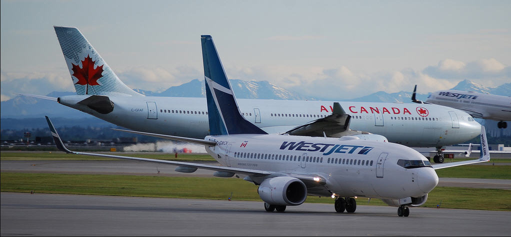WestJet and Air Canada Planes